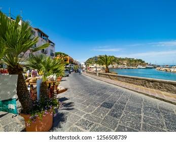 Lacco Ameno, Corso Angelo Rizzoli, beach with colorful houses and restaurant, island of Ischia, Naples, Gulf of Naples, Campania, Italy
