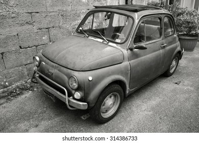 Lacco Ameno, Italy - August 15, 2015: Old Fiat Nuova 500 city car produced by the Italian manufacturer Fiat between 1957 and 1975 stands parked in a town