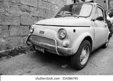 Lacco Ameno, Italy - August 15, 2015: Old Fiat Nuova 500 city car produced by the Italian manufacturer Fiat between 1957 and 1975 stands parked in a town, closeup photo