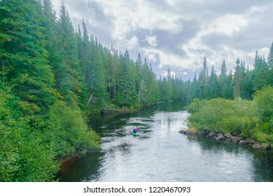 Lac-des-Dix-Milles, Canada - September 28, 2018: View of the Diable (Devil) River, with tourist in a kayak, in Mont Tremblant National Park, Quebec, Canada