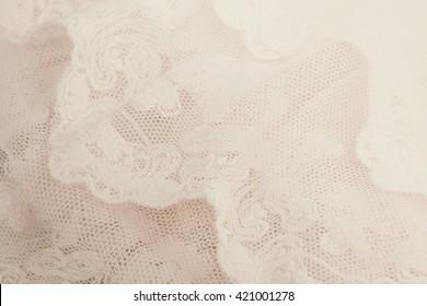 Lace beige background.