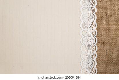 Lace border over burlap background