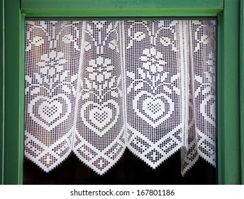 Lace curtain with a hearts, symbol of love