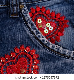 Lace decorative heart on blue denim background. Selective focus.
