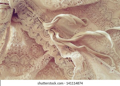 Lace: detail of a beige vintage clothing.