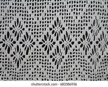 lace fabric on wooden background