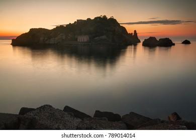 Lachea Island in Aci Trezza (Sicily - Italy) at sunrise.