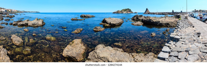 Lachea Island on Cyclopean Coast and the Islands of the Cyclops on Aci Trezza town (Italy, Sicily,10 km north of Catania). Known as Isoles Dei Ciclopi Faraglioni. People unrecognizable.