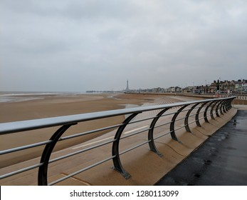 LACKPOOL, ENGLAND - DECEMBER 17, 2018: Blackpool beach, Lancashire, UK, from the south pier, with Blackpool Tower on the horizon, on a very cold, bracing winter day outside the tourist season