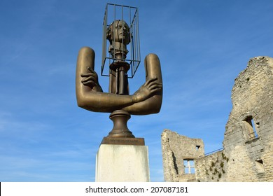 """LACOSTE, FRANCE - JUL 11, 2014: Statue of Marquis de Sade near ruins of his castle  The terms """"sadist"""" and """"sadism"""" are derived from Marquis de Sade's name"""