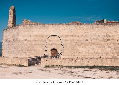 Lacoste, Vaucluse, Provence-Alpes-Cote d'Azur, France, September 25, 2018: The contour of the head of the Marquis de Sade around the gate to the castle of Lacoste