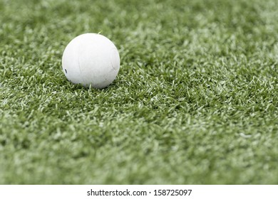 Lacrosse ball isolated on artificial turf with shallow depth of field and copy space