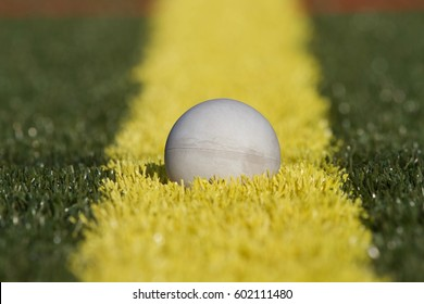 Lacrosse Ball on Yellow Line of Turf Field