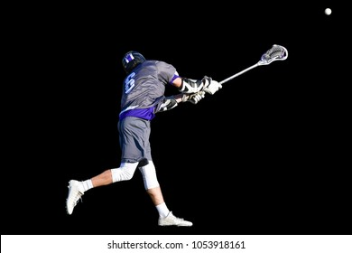 Lacrosse player Attempting a goal during an Intense match
