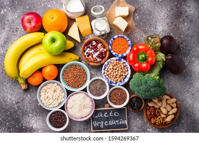 Lacto vegetarian diet concept. Fruits, vegetables, dairy products, seeds, healthy fats and grains