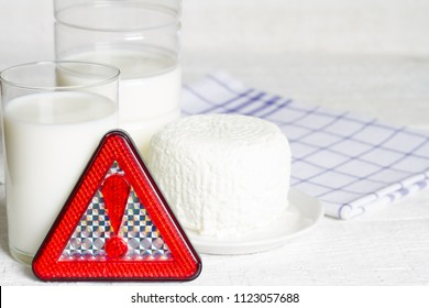 Lactose intolerance with milk dairy product and warning sign concept