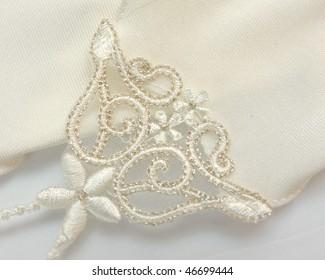 Lacy glove of white colour