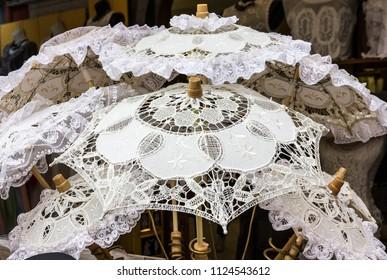 Lacy white umbrellas - traditional souvenires in Burano island, Venice, Italy