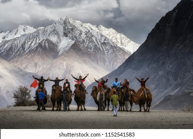 Ladakh/ India - April 27,2017 : Group of traveller enjoy Take a photo with camel in Nubra Valley