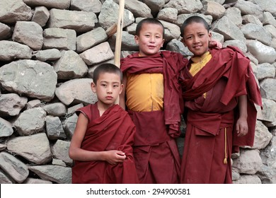 LADAKH, INDIA -AUG 30 :Unidentified Buddhist monks pose for a snap at Hemis monastery on August 30, 2012 in Ladakh, India. Hemis is the biggest tibetan monastery in Ladakh and a tourist attraction.
