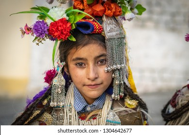 Ladakh, India - August 29, 2018: Portrait of an indigenous girl in traditional costume in Ladakh, India. Illustrative editorial.