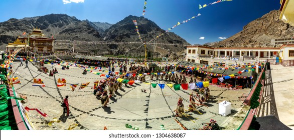 Ladakh, India - August 30, 2018: Performers in traditional costumes playing and dancing in Ladakh, India. Illustrative editorial.