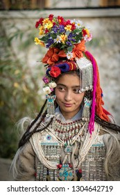 Ladakh, India - August 30, 2018: Portrait of a pretty young native girl in traditional costume during cultural festival in Ladakh, India. Illustrative editorial.