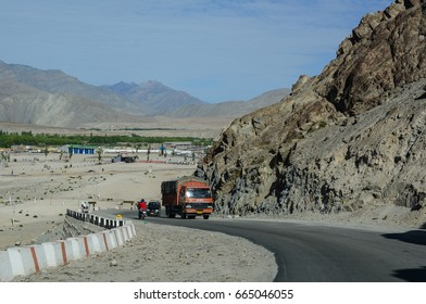 Ladakh, India - Jul 16, 2015.  Vehicles running on mountain road in Ladakh, India. Ladakh is the highest plateau in the state of Jammu & Kashmir with much of it being over 3,000m.
