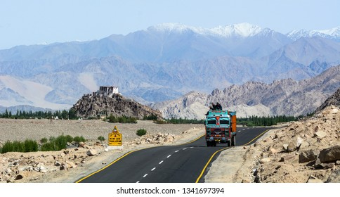 Ladakh, India - Jul 19, 2015. A truck running on mountain road in Ladakh, India. Ladakh is renowned for its remote mountain beauty and culture.