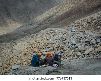Ladakh, India - Jul 20, 2015. People sitting on the mountain road in Leh, Ladakh, India. Ladakh is one of the most sparsely populated regions in Jammu and Kashmir.