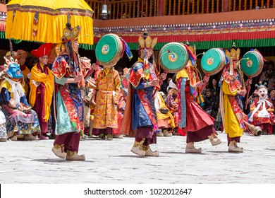 LADAKH, INDIA - JUNE 26, 2015 : Tibetan men, dressed in a mystical mask, perform a dance during the Buddhist festival in Hemis monastery, near Leh, Ladakh, Northern India