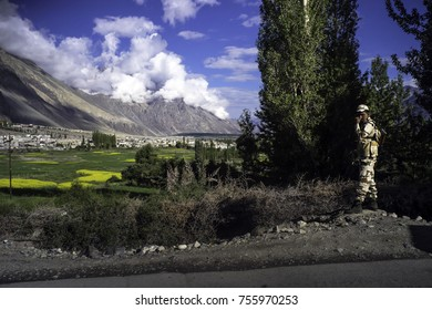 Ladakh, India, Nubra valley , July2017, a Indian soldier stands on the side of the road that leads up the Nubra valley