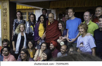 Ladakh, India, Nubra valley,Disket, July2017, His Holiness , Dalai Lama stands and holds hand for a group photo with some westerners at a special reception after the teaching in the Nubra valley
