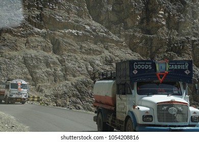 LADAKH, INDIA - SEP 12, 2017 - Truck on narrow, twisting road along the Indus River in deep valley, Ladakh, India