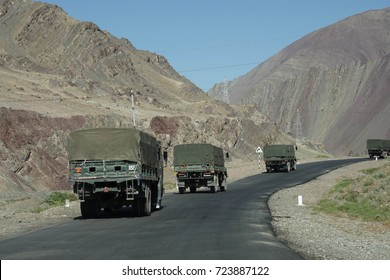 LADAKH, INDIA - SEP 12, 2017 - Indian army truck convoy on narrow road along Indus River,Ladakh, India