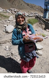 LADAKH, INDIA - SEP 13, 2017 -Young Ladakh woman sellng apricots, Ladakh, India