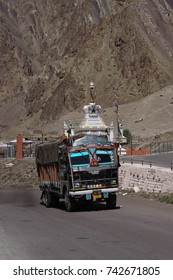 LADAKH, INDIA - SEP 13, 2017 - Painted lorry on narrow road above the Indus River, Ladakh, India