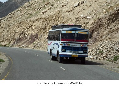 LADAKH, INDIA - SEP 13, 2017 - Painted bus on narrow road above the Indus River, Ladakh, India