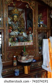 LADAKH, INDIA - SEP 14, 2017 - Altar with kata silk scarves and other donations,  Spituk gompa monastery, Ladakh, India