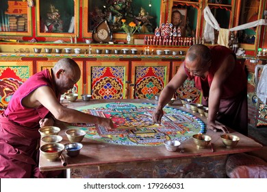 LADAKH, INDIA - SEPTEMBER 03, 2011: Buddhist monks making sand mandala in Diskit gompa at Nubra valley. Mandala - is a spiritual and ritual symbol in Hinduism and Buddhism, representing the Universe