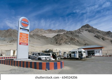 Ladakh, Leh, India - May 6, 2017 : travelers filling their car with petrol at indianoil gas station with mountain view and blue sky in Ladakh, Leh, India.