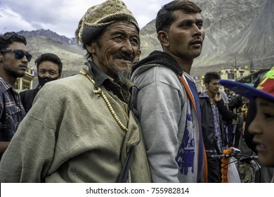 Ladakh,India, Nubra valley, Disket,July2017,old Ladakhi man in traditional clothes and mala smiles amongst some younger men in modern clothing
