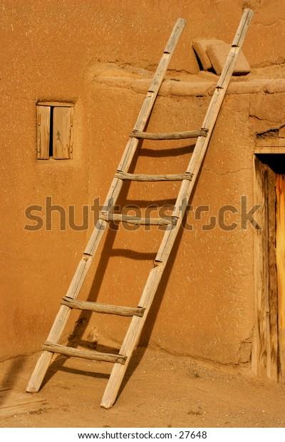 Ladder against the pueblo house.