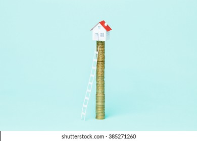 Ladder to climb a coin stack with your dreams house on top of it.