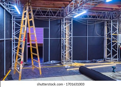 Ladder for construction work. Preparation of the premises for the concert. Construction of technical rooms near the stage. Concept - metal structures for a concert. Mounting of stage constructions