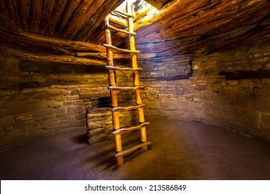Ladder descending into kiva, Mesa Verde National Park, Colorado.