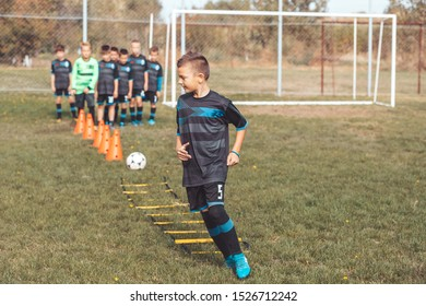 Ladder drills exercises for football Soccer Team. Young player exercises on ladder drills.