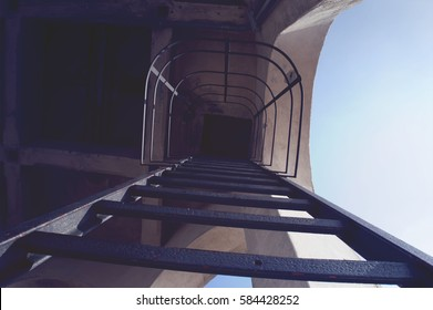 ladder with Fall Protection Systems of blue sky