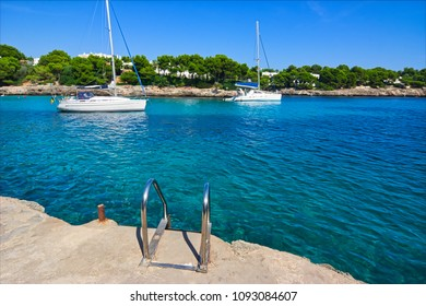 Ladder into the azure sea on a small bay in the mediterranean sea
