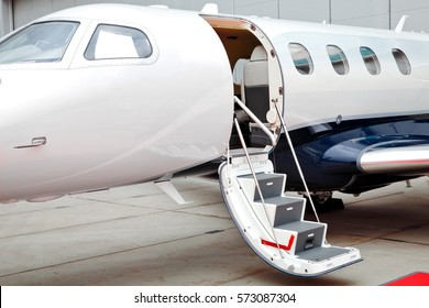 Ladder with open door in business jet airplane